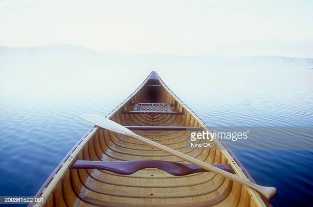 wood canoe in morning mist - rowing boat stock pictures, royalty-free photos & images