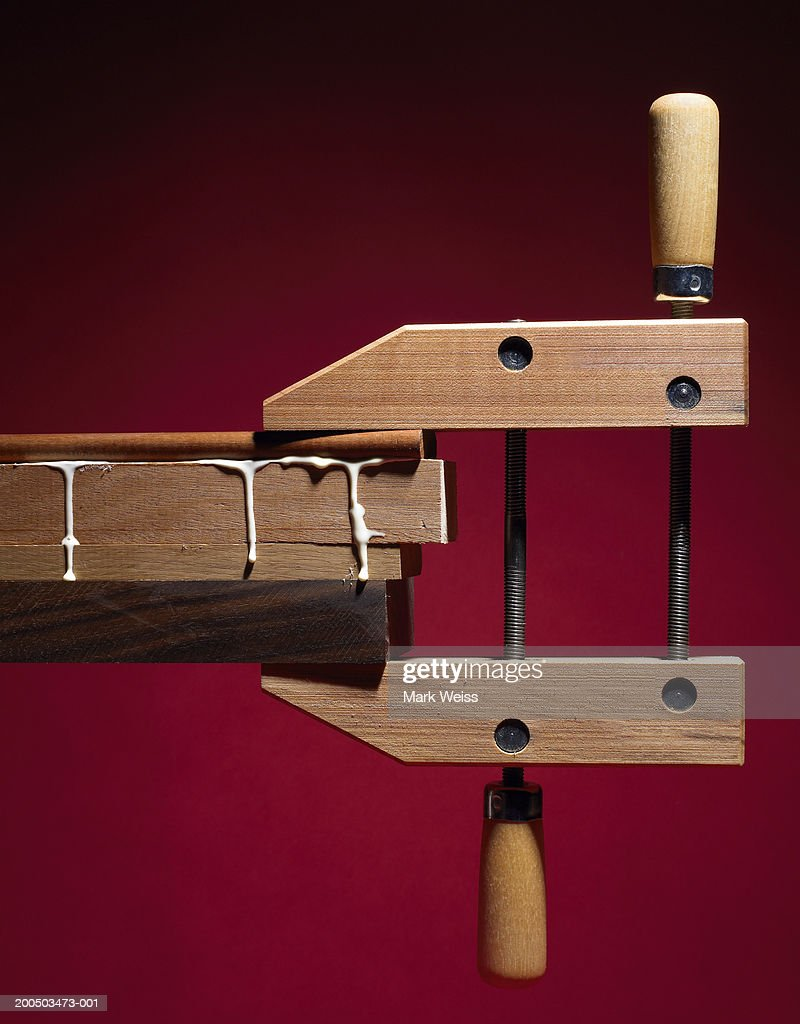 Wood clamp with wood and glue, studio shot : Stock Photo