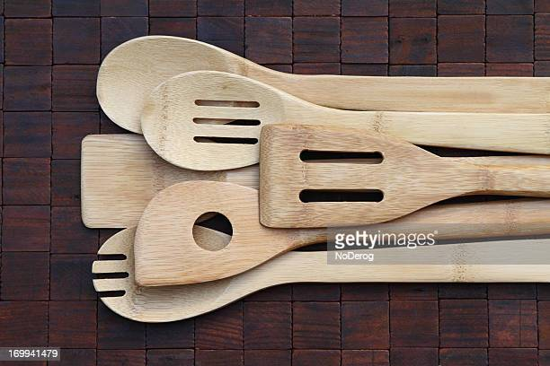 Wood cooking utensils on dark background