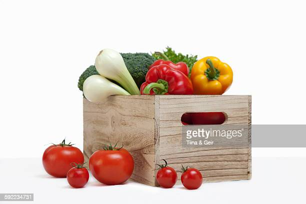 Wood crate filled with fresh vegetables