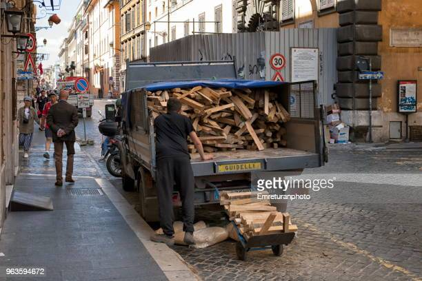 wood delivery by truck to a restaurant in rome. - emreturanphoto stock pictures, royalty-free photos & images