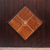 diamond shaped earth colored tiles brown