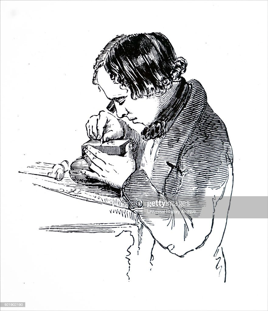 Wood engraving depicting an engraver working in a block with the aid of an eye-glass. Dated 19th century.