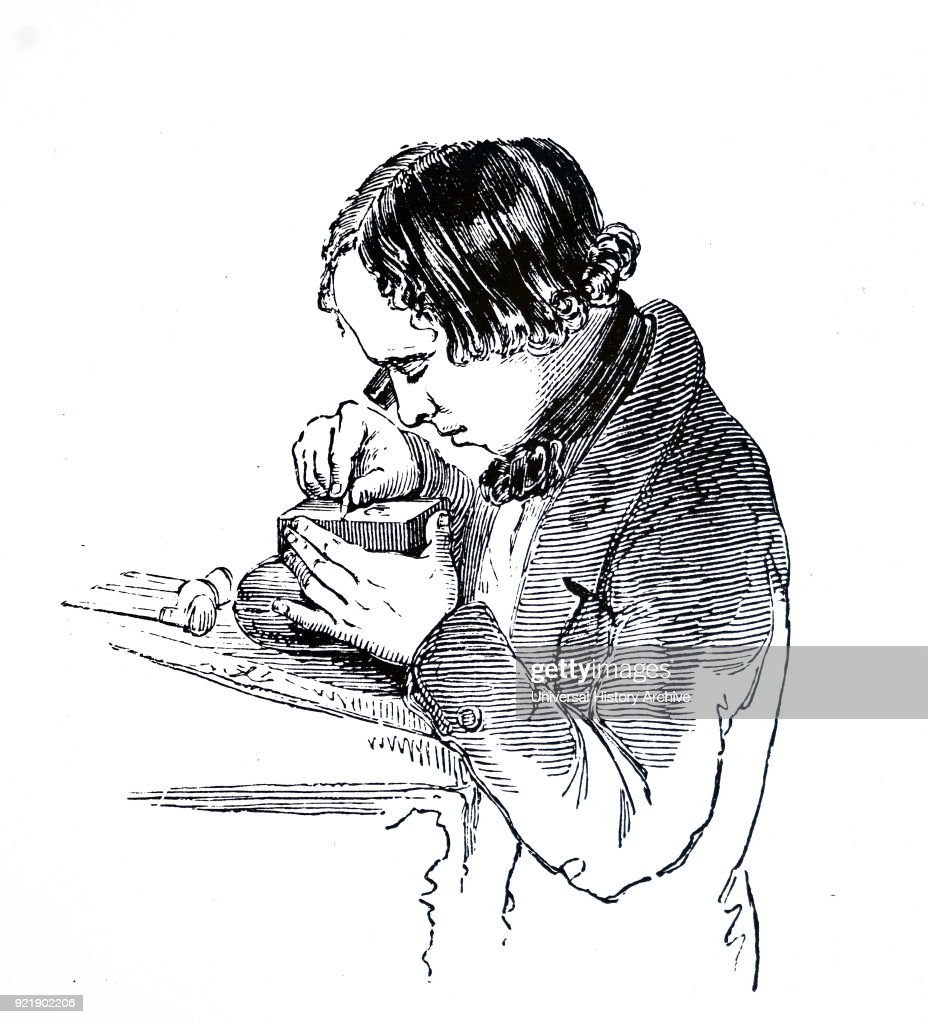 An engraver working. : News Photo