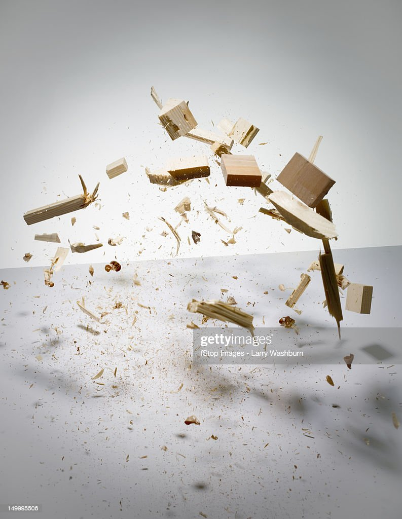 Wood exploding into pieces : Stock Photo