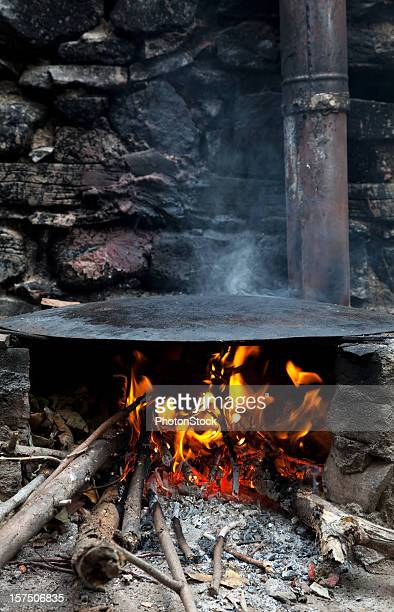 Wood fire and iron roller plate