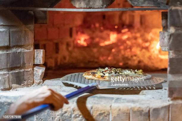 wood fire brick oven - pizza oven stock photos and pictures