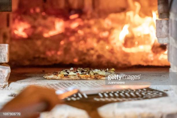 wood fire brick oven - pizzeria stock photos and pictures