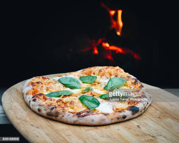wood fired artisan pizza - artisanal food and drink stock pictures, royalty-free photos & images
