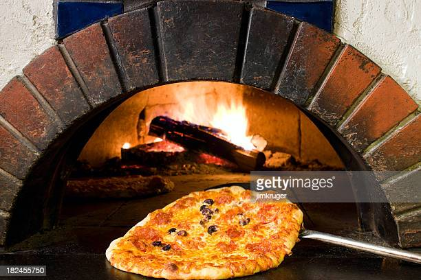 Wood fired oven and fresh pizza.