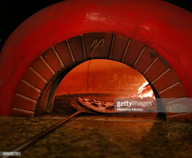 wood fired pizza - pizza oven stock photos and pictures