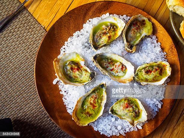 wood fired sewansecott oysters - template_talk:south_carolina stock pictures, royalty-free photos & images
