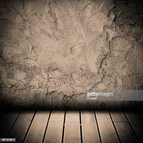 wood floor and concrete wall textured backgrounds in a room interior