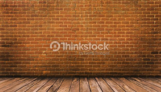 Wood Floor And Red Brick Wall Background Stock Photo