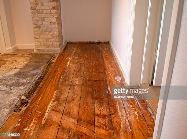 wood floor in serious need of repair and renovation  - wet stock pictures, royalty-free photos & images