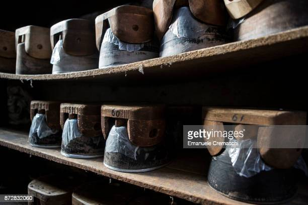 Wood for shaping is stored on shelves in the Vimercati Hats' workshop on March 1 2017 in Monza Italy Vimercati Hats is the last familyrun company...
