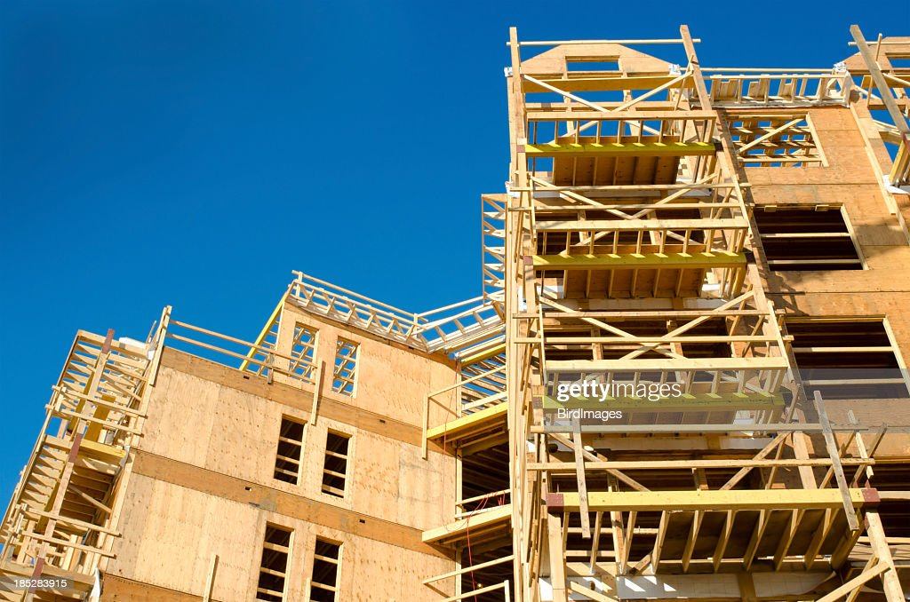 wood frame construction site stock photo - Wood Frame Construction
