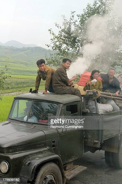 Wood gas truck on the road in rural North Korea. Wood gas is a substitute on many trucks in rural areas. A boiler is fired and wood added to give off...