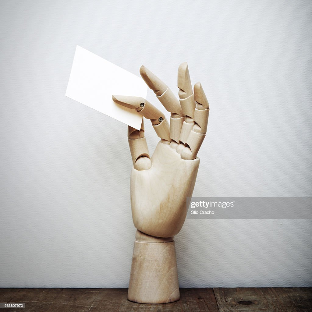 Wood hand holding blank business card : Foto stock