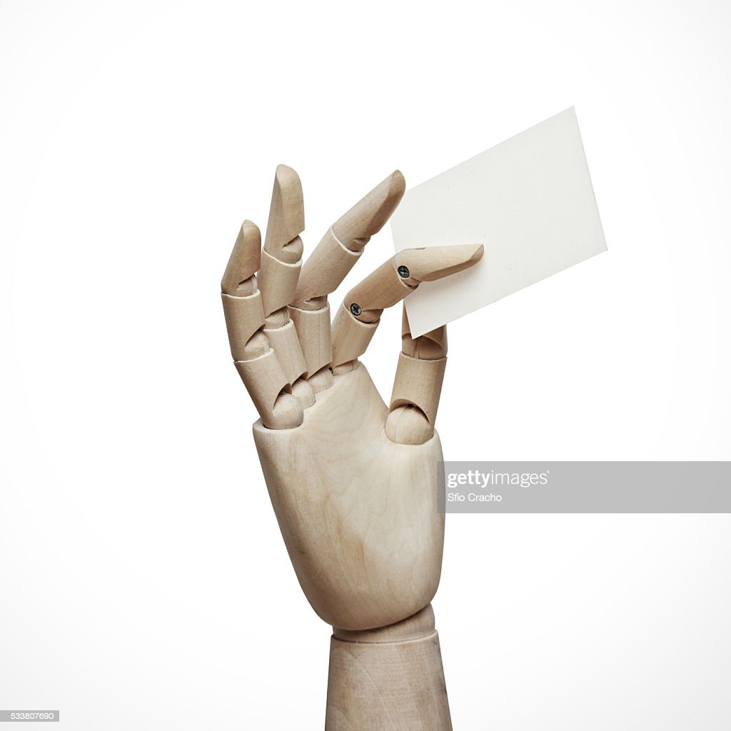 Wood hand with blank business card : Foto stock