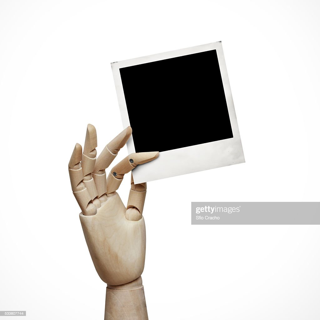 Wood hand with instant photo frame : Foto stock