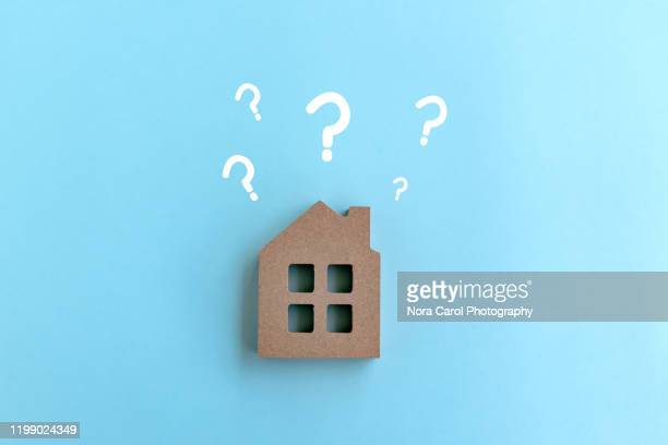 wood house model with question marks - image stock pictures, royalty-free photos & images