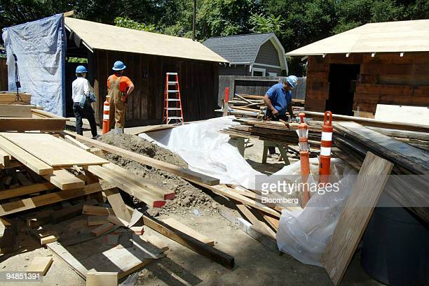 Wood is stacked near the 'HP garage,' building at left, as restoration continues on the grounds of 367 Addison Ave. In Palo Alto, California...