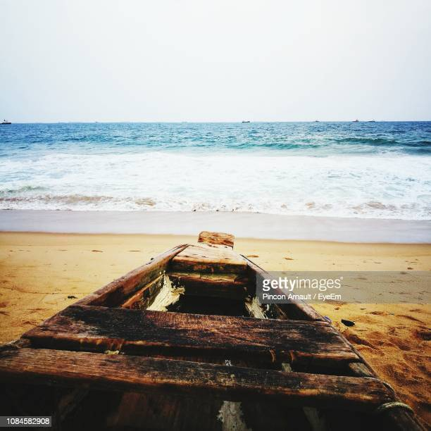 wood on beach against clear sky - arnault stock pictures, royalty-free photos & images