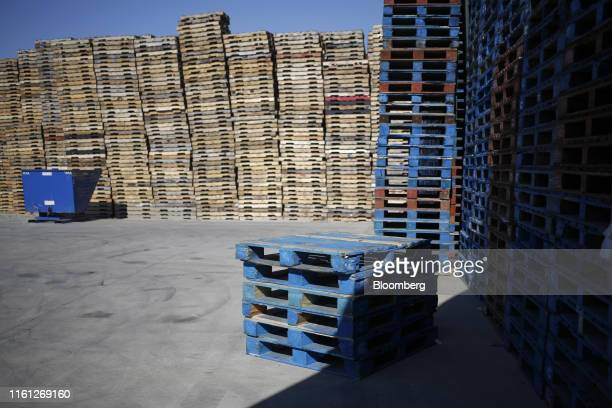 Wood pallets sit stacked outside the packing shed during a watermelon harvest at Frey Farms Inc in Poseyville Indiana US on Thursday Aug 1 2019...