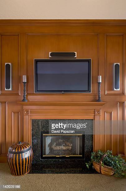 wood paneled walls and fireplace - man cave stock pictures, royalty-free photos & images