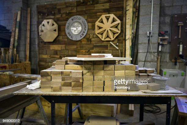 Wood pieces sit stacked on a table at the Old Wood Co sustainable furniture manufacturing facility in Asheville North Carolina US on Wednesday April...