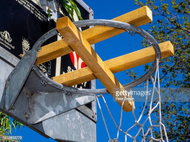 Wood placed in basketball hoops to prevent play in Chestnuts Park on April 22 2020 in London England Tapedoff benches and other social distancing...
