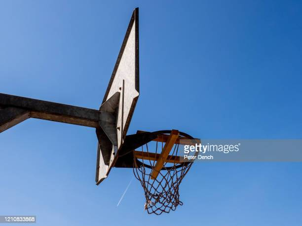 """Wood placed in basketball hoops to prevent play in Chestnuts Park on April 22, 2020 in London, England. Taped-off benches and other """"social..."""