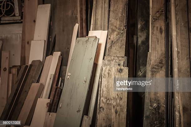wood stacked together in artists workshop - heshphoto stock pictures, royalty-free photos & images