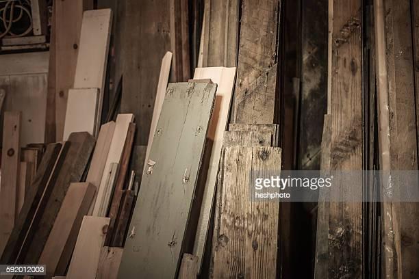 wood stacked together in artists workshop - heshphoto ストックフォトと画像