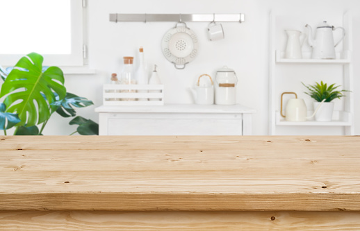 Wood table top for product display on blur kitchen background 1171133130