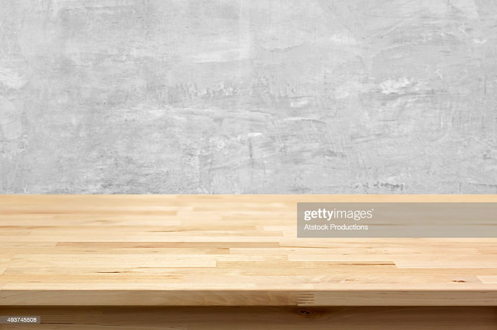 table top. Wood Table Top On Bare Concrete Wall Background