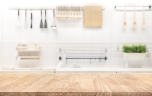 Wood table top on blur kitchen room background 934922794