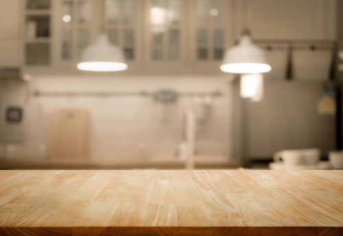 Wood table top on blur kitchen wall room background 867795548