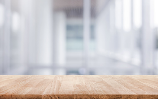 Wood table top on white abstract background form office building. 924418506