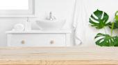 Wood tabletop on blur bathroom background, design key visual layout