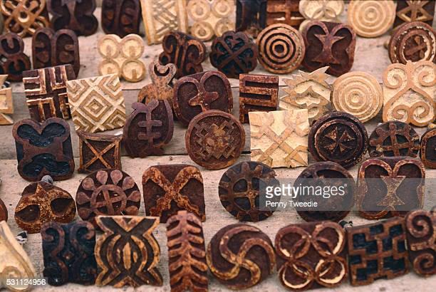 wood textile stamps for making kente cloth - kente fotografías e imágenes de stock