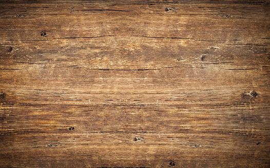 Wood texture background. Top view of vintage wooden table with cracks. Surface of old knotted wood with natural color, texture and pattern. Dark barn material. 1201918805