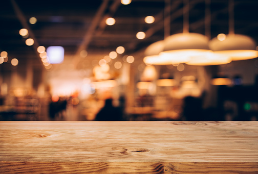 Wood texture table top (counter bar) with blur light gold bokeh in cafe,restaurant background.For montage product display or design key visual 1129661826