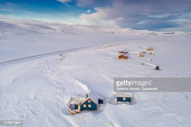 wood traditional houses in the snow, sennalandet, finnmark, norway - norway stock pictures, royalty-free photos & images