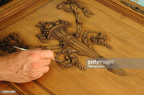 Wood worker repairing oak cabinet door