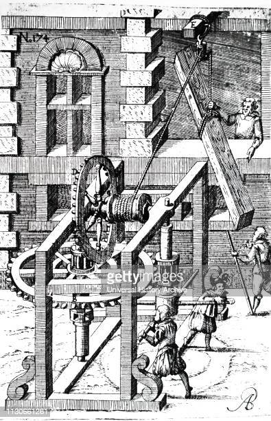 Woodcut engraving depicting the raising of a large piece of timber using a rope and pulley, and a man-powered windlass with tooth and pinion and...