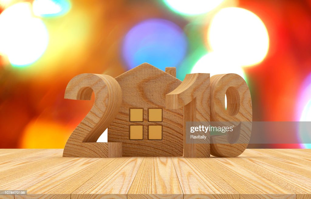Wooden 2019 with house icon and bokeh lights : Stock Photo