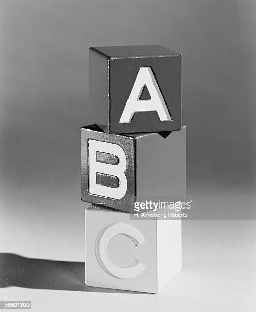 Wooden A B C alphabet blocks stacked vertically