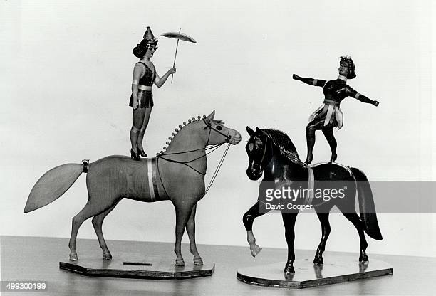 Wooden acrobats: These fine and detailed carved wooden acrobats standing on back of circus horses were made in the 1930s by William G. Loney; a...